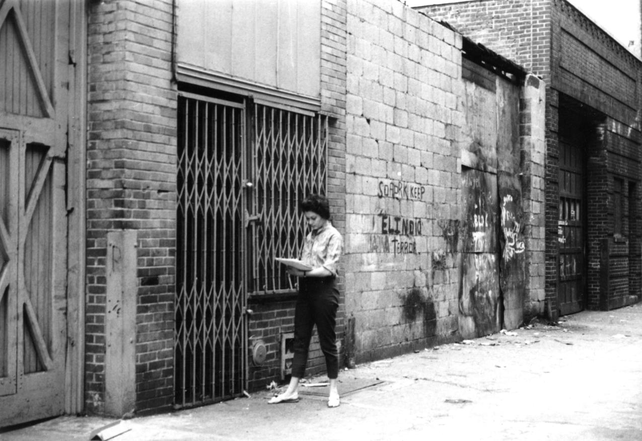 Frances Golden surveying vacants. Cooper SQ-1963-1964