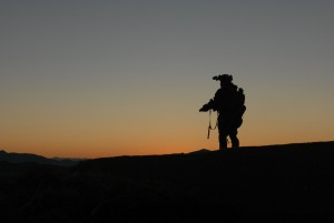 A U.S. Army Special Forces Soldier, with Special Operations Task Force – South, scans the horizon for enemy activity in Shah Wali Kot District, Kandahar Province, Afghanistan during a clearing operation Feb. 8, 2011 alongside Afghan Commandos from 2nd Company, 3rd Commando Kandak. The commandos, along with District Chief of Police, Bacha Khan, detained 20 suspected insurgents for questioning. The partnered units also found 80 pounds of homemade explosives and various improvised explosive device making components on the operation. (U.S. Army photo by Staff Sgt. Jeremy D. Crisp)(Released).