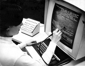 Original photo by Greg Lloyd 1969, used with permission. Photo of the Hypertext Editing System (HES) console in use at Brown University, circa October 1969. HES was developed by Prof Andries (Andy) van Dam, Ted Nelson, David Rice, Steve Carmody, Walter Gross, and others as an IBM sponsored research project. The HES software was distributed without charge by IBM and used by researchers and NASA. The photo shows HES on an IBM 2250 Mod 4 display station, including lightpen and programmed function keyboard, channel coupled to Brown's IBM 360 mainframe. CC BY 2.0