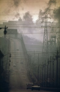 """DARK CLOUDS OF FACTORY SMOKE OBSCURE CLARK AVENUE BRIDGE - NARA - 550179"" by Frank J. (Frank John) Aleksandrowicz, 1921-, Photographer (NARA record: 8452210) - U.S. National Archives and Records Administration. Licensed under Public Domain via Commons - https://commons.wikimedia.org/wiki/File:DARK_CLOUDS_OF_FACTORY_SMOKE_OBSCURE_CLARK_AVENUE_BRIDGE_-_NARA_-_550179.jpg#/media/File:DARK_CLOUDS_OF_FACTORY_SMOKE_OBSCURE_CLARK_AVENUE_BRIDGE_-_NARA_-_550179.jpg"