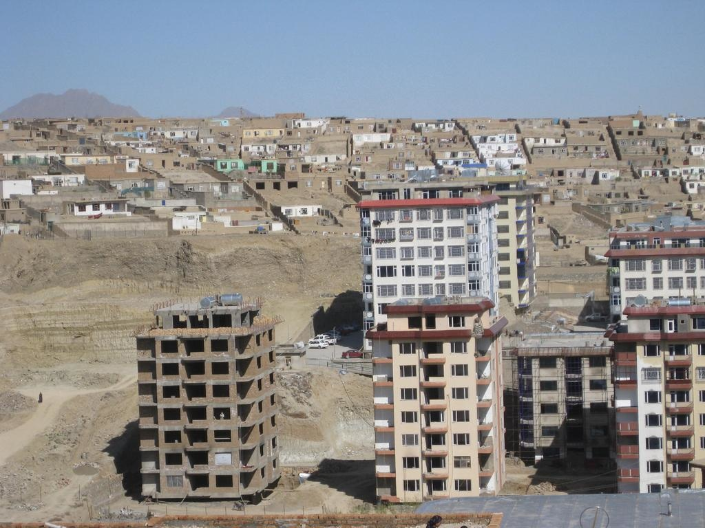 "One of Kabul's ""life-style"" gated-townships amid its overall context of poverty and informality. © Mona Khechen, 2011."