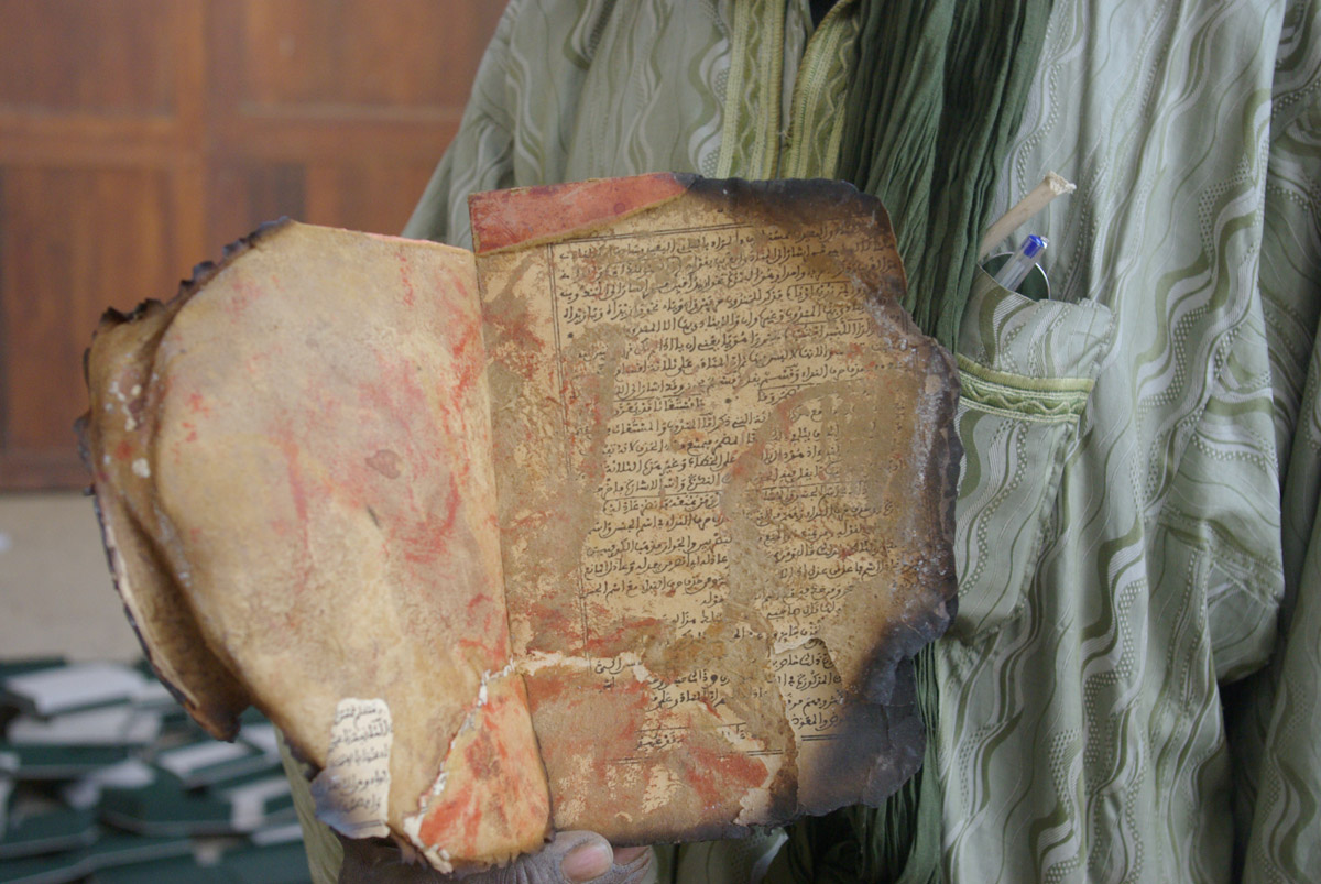 A burnt manuscript recovered from Timbuktu and preserved at Bamako under partnership with UNESCO. Image ©UNESCO/A. Maiga