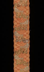 Coral coloured ribbon made of woven silk, with gilded silver thread, France, 1720-50. London, Victoria and Albert Museum, 1355-1871