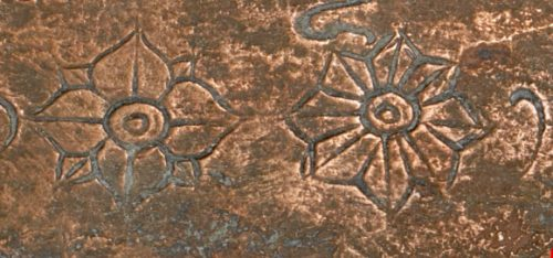 Floral motifs marking the end of the text of the Sobhāmṛta inscription. British Library, MSS Jav 106, f. 5v