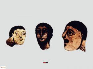 Fig. 2 Vitraux romans de Jumièges, trois têtes d'hommes (cl. E. Broine, Craham).