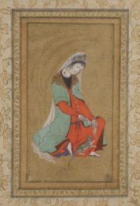 Femme jouant avec un chat