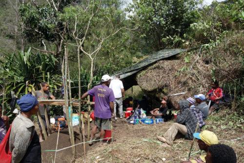 Villagers observing work starting at Manim site under.