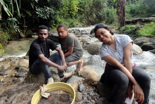 Jeivin and Chloe, University of PNG students, sieving at the Manim creek.