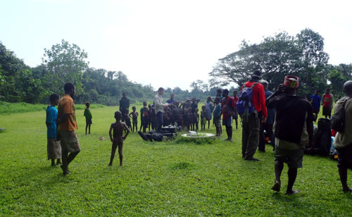 Karawari airfield (East Sepik): local people looking at C. Joly while he was shooting the aircraft arrival from the drone.