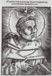 """""""Martinus Luther, ein dyener Jhesu Christi, und ein wideruffrichter christlicher leer."""" (Holzschnitt von Hans Baldung Grien, 1521)."""