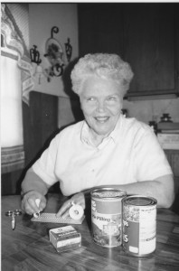 """Elaine Marken using a slate and stylus to create Braille labels for canned foods,"" http://www.iowablindhistory.org/blindhistory/household-tasks. ""Courtesy of Iowa Blind History Archive at the Iowa Department for the Blind."""