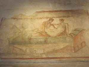 Sexual scene on one of the walls of the lupanar at Pompeii. Photo: Laurence Totelin, October 2014