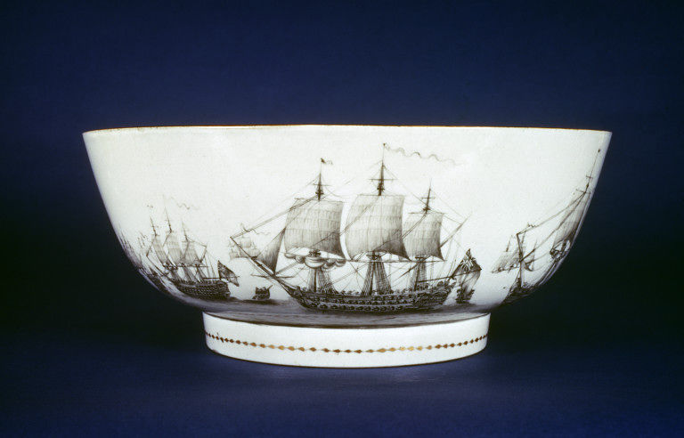 Punch bowl of porcelain, painted en grisaille and gilt. Outside are two scenes, one showing a sea battle and the other, ladies in an English park. Made in Jingdezhen, China, ca. 1785. Artist/maker unknown. Victoria and Albert Museum.