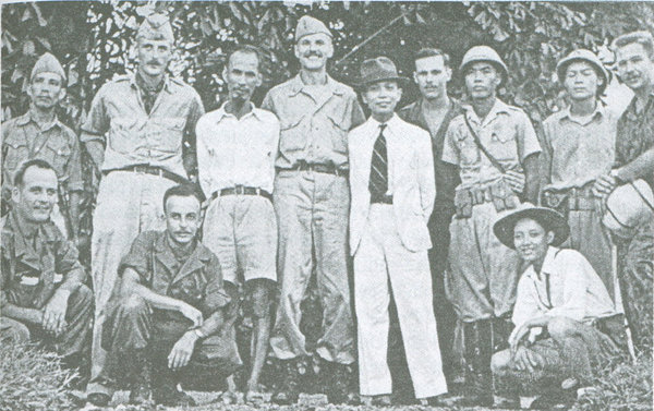 Members of the O.S.S. Deer Team with Viet Minh leaders, including Ho Chi Minh, (standing third from left) during training in 1945. Henry Prunier is fourth from right.