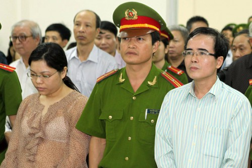 Le Quoc Quan, right, listens to the judge during his trial in Hanoi, Vietnam. © 2013 Associated Press